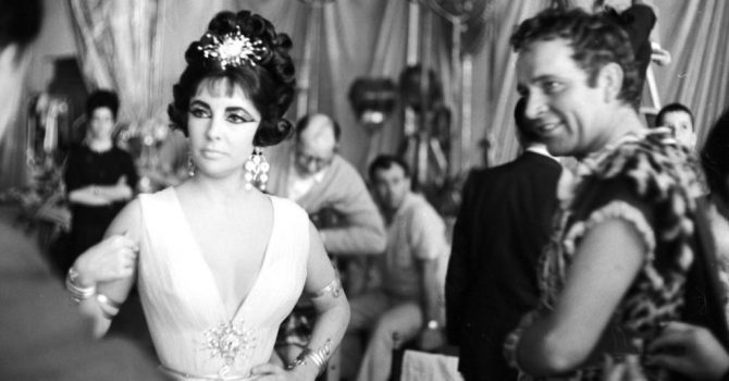 Elizabeth Taylor and Richard Burton in costume on the set of 'Cleopatra' in Rome, Italy in 1962. Taylor's glam ensemble includes a snake bracelet and armband. Photo By Paul Schutzer/Time Life Pictures/Getty Images