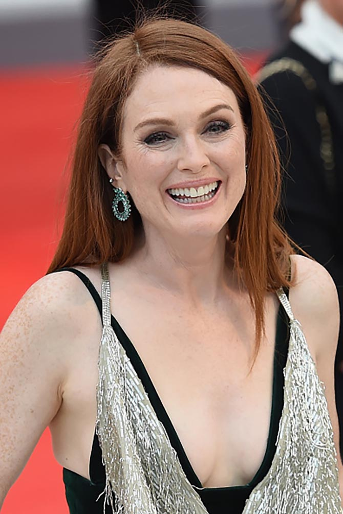 At the Venice Film Festival premiere of 'Suburbicon,' Julianne Moore wore emerald earrings from Chopard Photo by Stefania D'Alessandro/WireImage