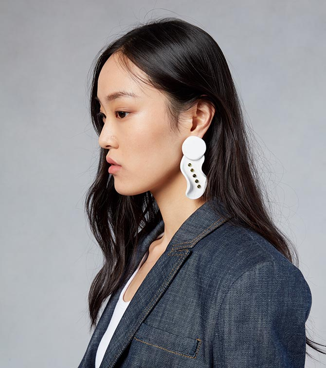Model from the Tibi show wearing the black spinel and white ceramic earring done in collaboration with Paige Novick and Githan Coopoo Photo courtesy of Tibi