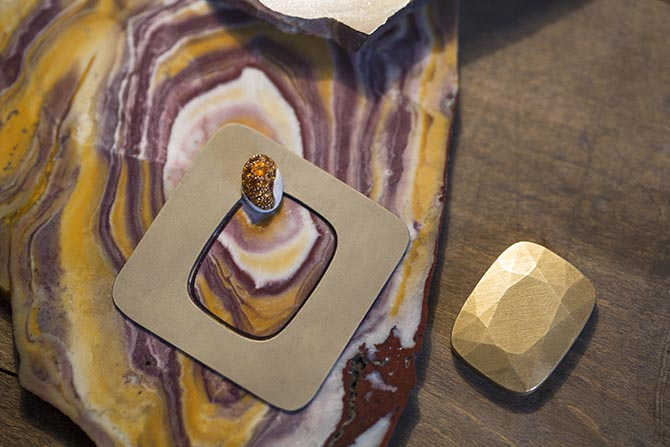 Selecting the portion from a rough piece of Yellow Red Banded Jasper for a one-of-a-kind ring in Pomellato's 50th Anniversary Collection. Photo courtesy