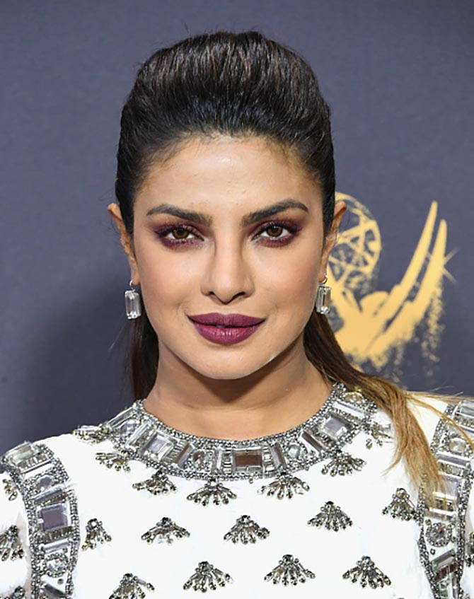 Priyanka Chopra echoed the pattern on her Balmain gown with gigantic diamond earrings by Lorraine Schwartz