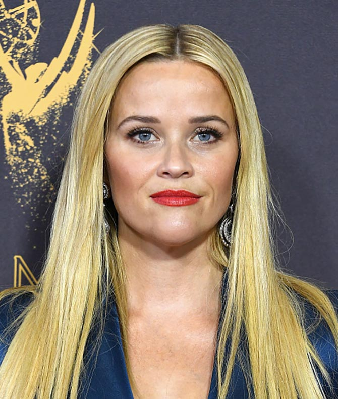 At the Emmys Reese Witherspoon wore diamond, white gold and platinum earrings by David Webb