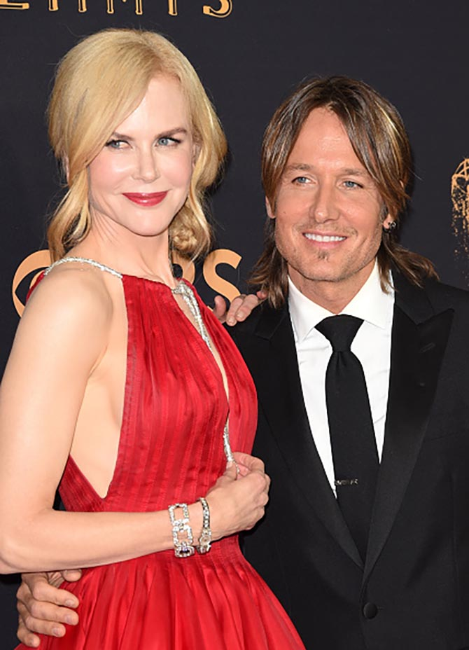 Keith Urban with Nicole Kidman who is wearing $2 million in diamond and platinum jewelry from Harry Winston as well as a vintage Omega watch