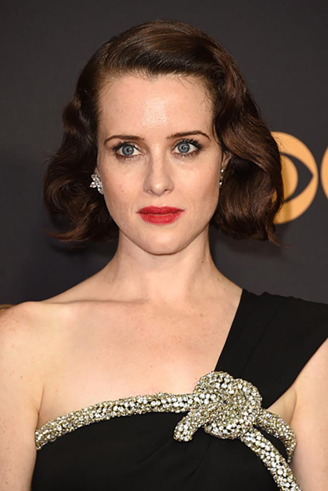 Claire Foy in diamond and platinum cluster earrings by Harry Winston
