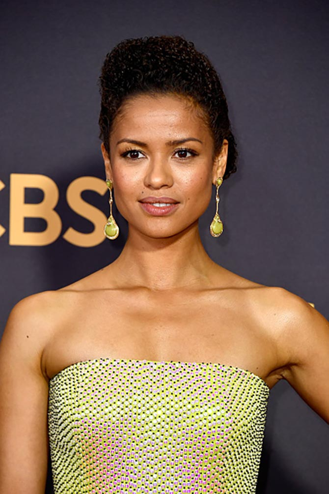 Gugu Mbatha-Raw matched her neon Hugo Boss gown with earrings by Fernando Jorge