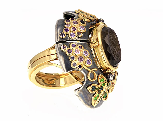 A ring from Elie Top's Cosmogonie Secrète collections features colorful semi precious stones surrounding an intaglio. Photo courtesy