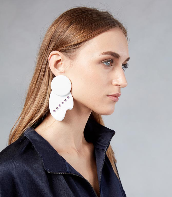 Model from the Tibi show wearing the earring done in collaboration with Paige Novick and Githan Coopoo