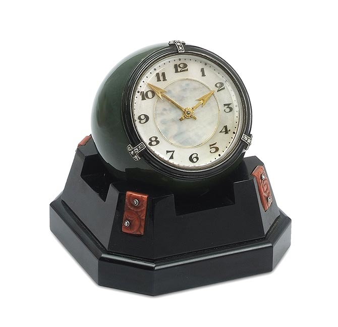 A Cartier art deco onyx, coral, nephrite and diamond spherical clock from the Symbolic & Chase collection. Photo courtesy