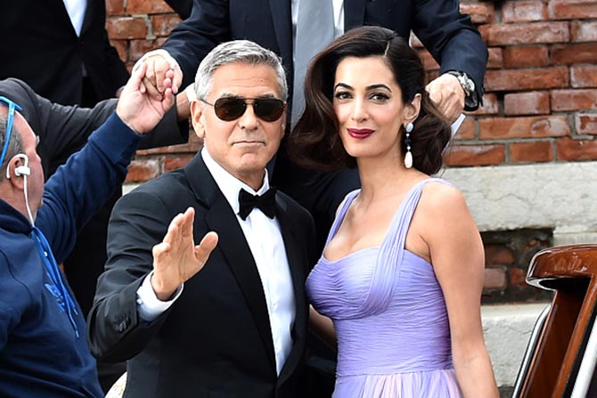 George Clooney and Amal Clooney leaving Hotel Cipriani by water taxi for the premiere of 'Suburbicon' Photo by Jacopo Raule/GC Images