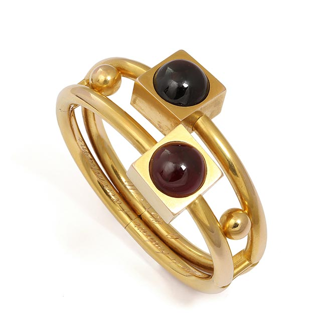 A 19th century cabochon garnet and yellow gold bangled from the Symbolic & Chase collection. Photo courtesy
