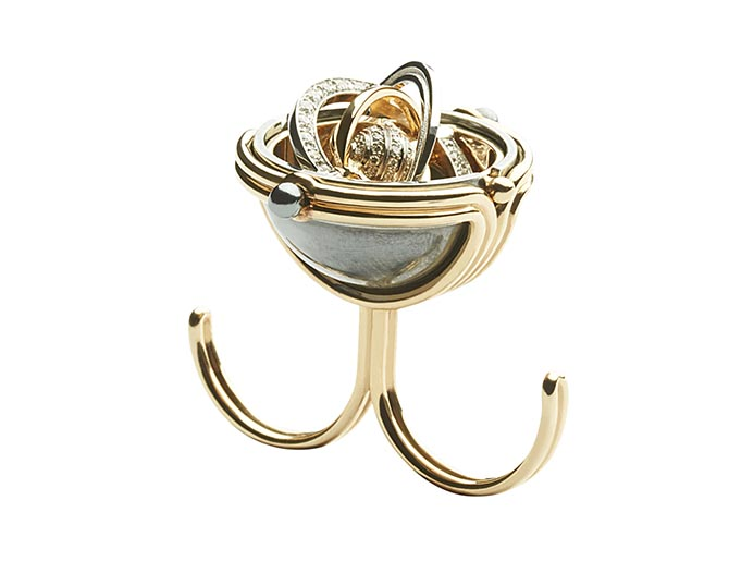 The between the finger ring from Elie Top's Mécaniques Célestes shown open. The interior was inspired by an armillary sphere. Photo courtesy