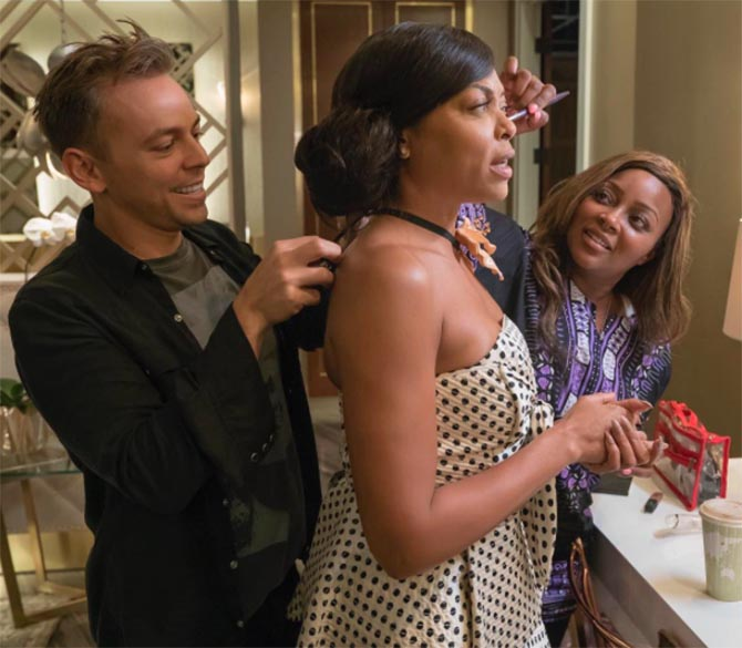 Makeup artist Ashunta Sheriff touching up Taraji while Nieddu adjusts her Gucci necklace behind-the-scenes of a Season 3 episode of 'Empire.' Photo @pniddy/Instagram