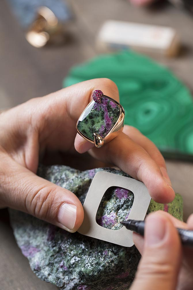 Secret Garden Pomellato 50th Anniversary ring and a rough zoisite ruby. Photo courtesy