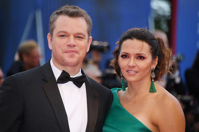 Matt Damon with his wife Luciana who is wearing emerald tassel earrings by Narcisa Pheres.