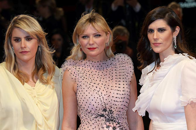 Kirsten Dunst wearing Irene Neuwirth earrings stands between the directors of 'Woodshock,' Kate Mulleavy also in Irene Neuwirth earrings and Laura Mulleavy in Cartier earrings. Photo Getty