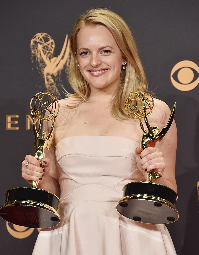 Elizabeth Moss holding her Emmys and wearing the Forevermark Custom Two Stone Bar Earrings by Karla Welch Photo by Alberto E. Rodriguez/Getty Images