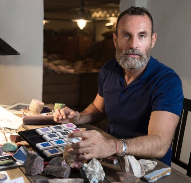 Pomellato Creative Director Vincenzo Castaldo reviewing gemstones. Photo courtesy