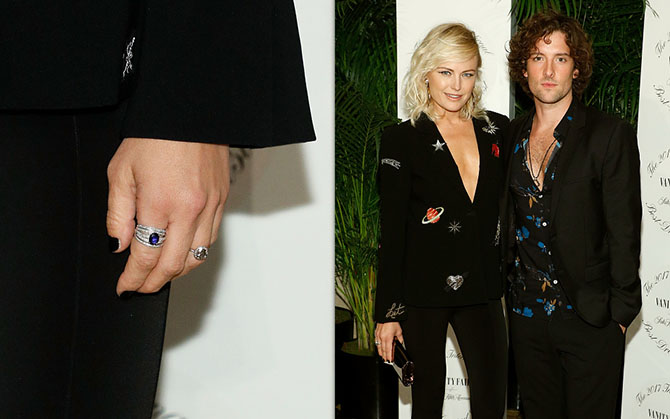 Detail of Malin Akerman's had showing her galaxy diamond engagement ring designed by Soraya Silchenstedt. Malin wearing a Cinq á Sept jacket with stars and Saturn with her fiancé Jack Donnelly on October 19, 2017 at the Vanity Fair And Saks Fifth Avenue 2017 International Best-Dressed List Party Photo Getty