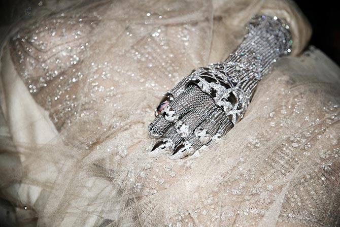 Daphne Guinness wearing the Contra Mundum Evening Glove of 18K white gold and diamonds during the preview party for the piece in 2011. Photo Rachel Chandler via Vogue.com