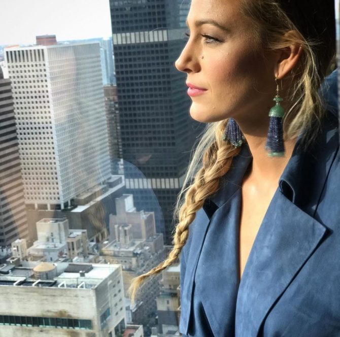 "A comedian to the end, Blake Lively captioned this photo ""Looking back on my thousands of outfit changes like..."" She is wearing Lorraine Schwartz green jade and sapphire tassel earrings in the image take at the Four Season hotel in Manhattan."