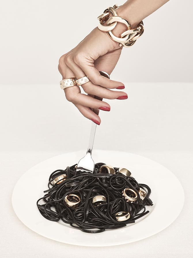 Rings from Pomellato's Iconica collection garnish the squid ink pasta and the models fingers. She is also wearing a Tango bracelet from the Italian jeweler. Photo courtesy