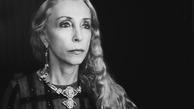 A still of Franca Sozzani wearing a cameo suite from Franca: Chaos & Creation. Photo courtesy of Francesco Carrozzini