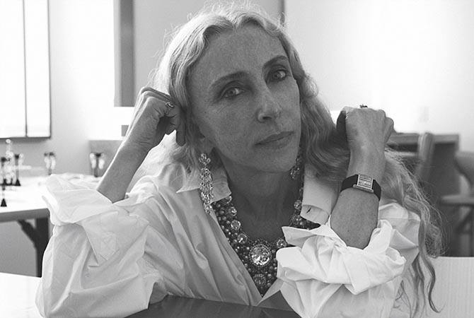 Franca Sozzani in pedant earrings, layers of necklaces and a watch. Photo courtesy of Francesco Carrozzini