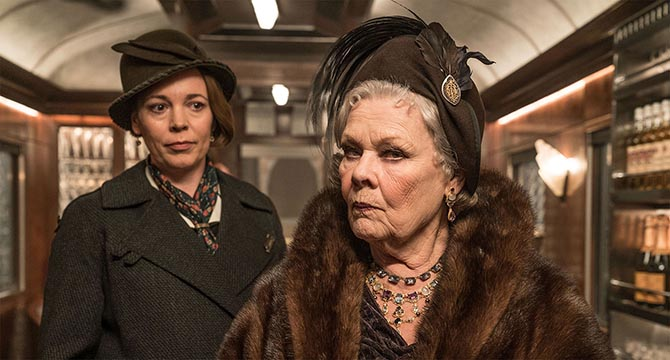 Olivia Colman with Judi Dench wearing layers of necklaces in 'Murder on the Orient Express.' Photo Twentieth Century Fox