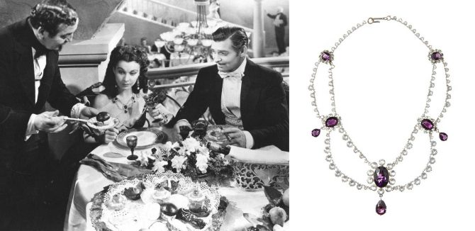 Film still of 'Gone with the Wind' (1939) of Rhett Butler (Clark Gable) dining with Scarlett O'Hara (Vivien Leigh) wearing a multi-strand tiered necklace with simulated diamonds and amethysts. Photo Getty and Julien's Auctions