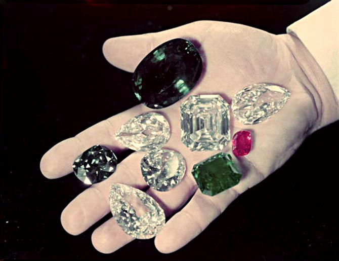 Harry Winston holding some of his famous gems including the Hope Diamond (between his middle and index finger) that he donated to the Smithsonian in 1958. Photo The LIFE Picture Collection/Getty Images