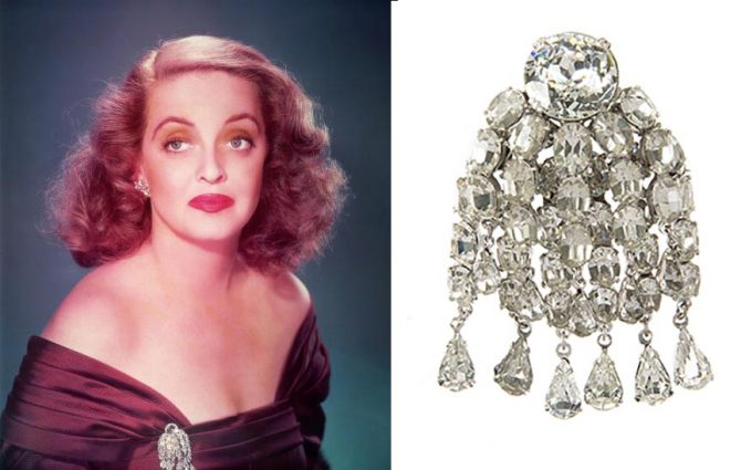 n a publicity still for 'All About Eve,' Bette Davis posed in one of her costumes for the film including the Joseff of Hollywood simulated diamond brooch at right. Julien's Auctions estimate for the brooch is $5,000 - $7,000. Photo Hulton Archives and Julien's auctions