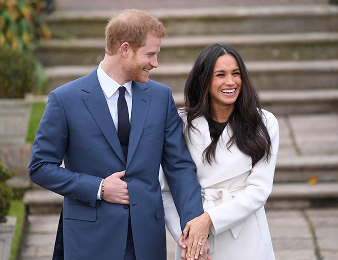 Prince Harry with Meghan Markle who is showing her engagement ring for the first time at the photo call announcing their engagement on November 27, 2017. Photo by Karwai Tang/WireImage