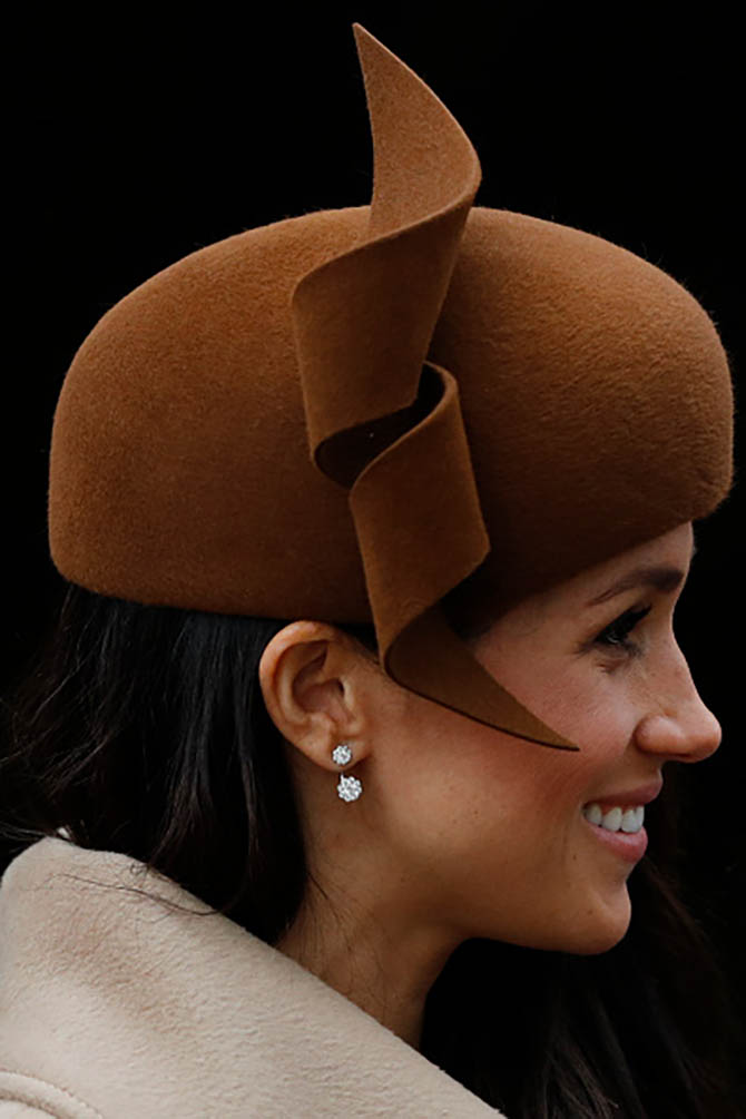 Meghan Markle wore a hat by Philip Treacy and diamond earrings from Birks to the Royal Family's traditional Christmas Day service at St Mary Magdalene Church in Sandringham, Norfolk, eastern England, on December 25, 2017. Photo ADRIAN DENNIS/AFP/Getty Images