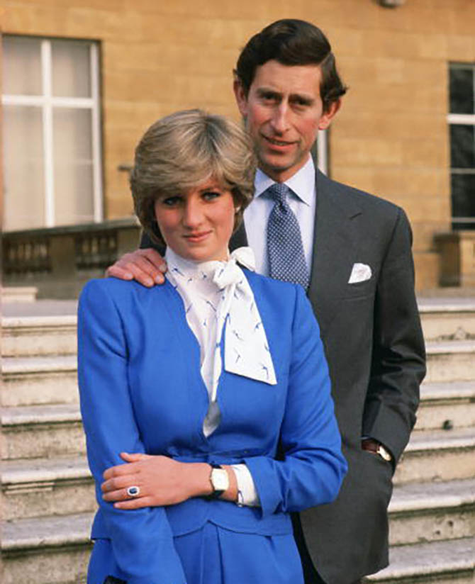 Lady Diana Spencer reveals her sapphire and diamond engagement ring as she poses with Prince Charles, Prince of Wales pose for photographs in the grounds of Buckingham Palace following the announcement of their engagement. Photo by Tim Graham/Getty Images