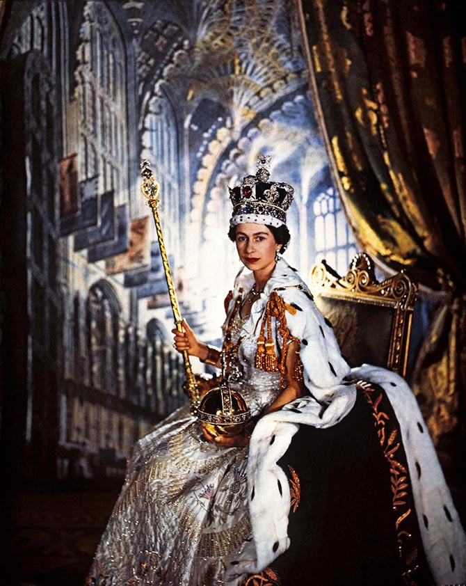 Queen Elizabeth posed for famed lensman Cecil Beaton on her coronation day, June 2, 1953, wearing the Imperial State Crown. In one hand she is holding the Sovereign's Sceptre set with 503.2-carat Cullinan I, the largest diamond in the world. In the other hand she is holding, the Cross and Sovereign's Orb. Photo Victoria and Albert Museum