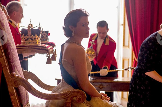 Claire Foy as Queen Elizabeth in the final episode of season 1 of 'The Crown' surrounded by jeweled symbols of the monarchy. Photo Netflix