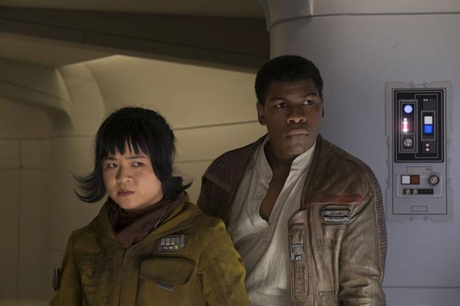 In a scene from 'The Last Jedi' Finn (John Boyega) is with Rose (Kelly Marie Tran) who is wearing her necklace. A glimpse of the chain can be seen between her coat and scarf. Photo © 2017 Lucasfilm Ltd.
