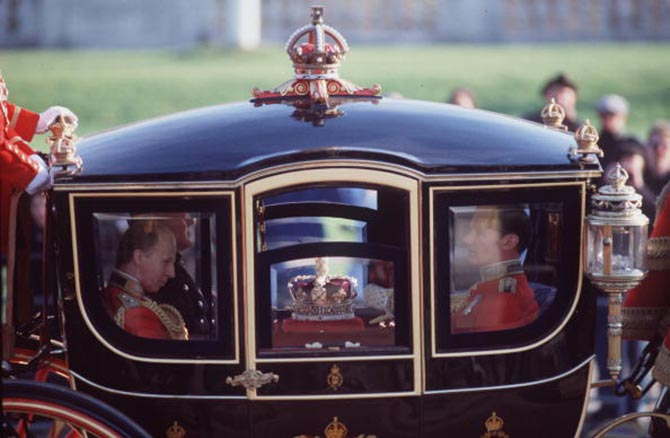 The Imperial State Crown being taken to the state opening of Parliament Ceremony in the Queen Alexandra State Coach during the 1990s. Photo by Tim Graham/Getty Images