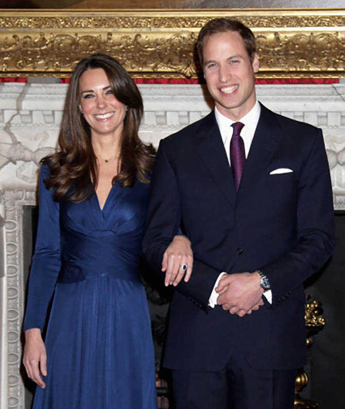 Kate Middleton wearing the sapphire and diamond engagement ring by Garrard poses with Prince William for photographers in the State Apartments of St James Palace on November 16, 2010 in London, England as they announce their engagement to the press. Photo by Chris Jackson/Getty Images