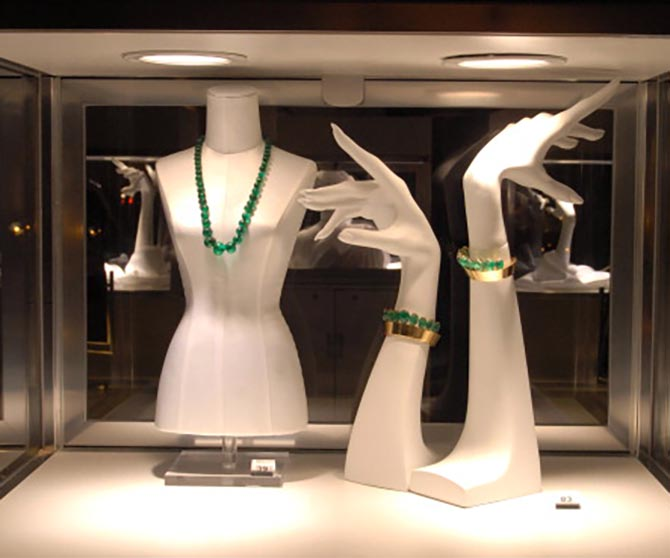 Display of Ellen Barkin's emerald necklace and Belperron coronet cuffs from the collection of the Duchess of Windsor at Christie's in 2006. Photo by Marko Georgiev/WireImage