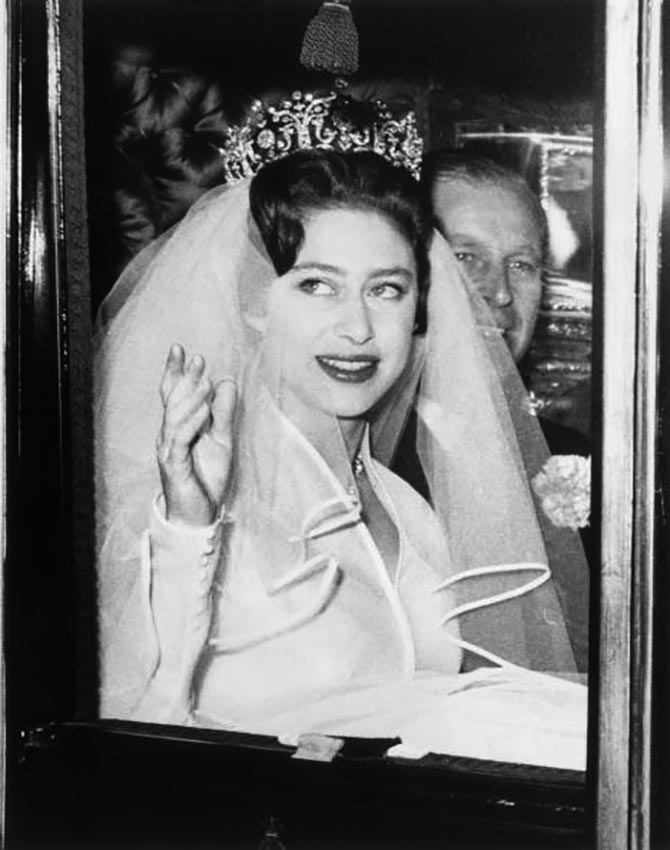 Princess Margaret wearing the Poltimore tiara on her way to Westminster Abbey to marry Antony Armstrong-Jones with Prince Philip who is gave her away. Photo by Hulton Archive/Getty Images