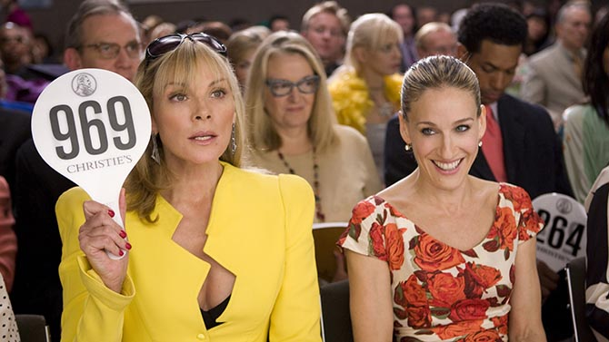 Sarah Jessica Parker with Kim Cattrall who is bidding on a flower ring from a divorcee's collection at Christie's in the 2008 'Sex and the City' movie. Photo New Line Cinema/Warner Bros. Pictures