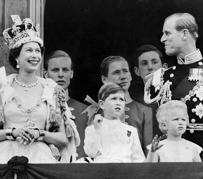 Queen Elizabeth II wearing the Imperial State Crown with Prince Philip and other members of her family on the balcony at Buckingham Palace after the coronation in 1953. Photo Getty
