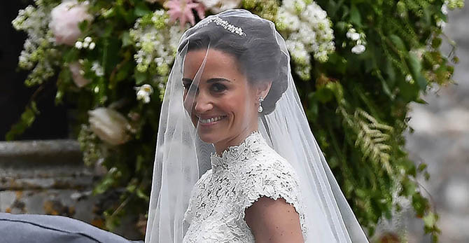 Pippa Middelton on her wedding day wearing a Maidenhair Fern tiara and diamond pendant earrings from the London jeweler Robinson Pelham Photo Getty