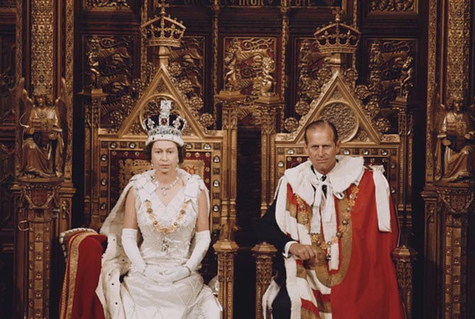 Queen Elizabeth II wearing the Imperial State Crown and Prince Philip in the House of Lords chamber during the State Opening of Parliament in 1970. Photo Getty Images