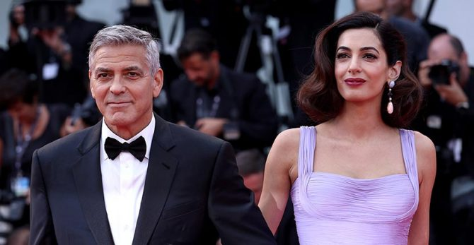At the 2017 Venice Film Festival screening of 'Suburbicon,' George Clooney with Amal Clooney who is wearing pendant earrings by Lorraine Schwartz Photo Franco Origlia/Getty Images