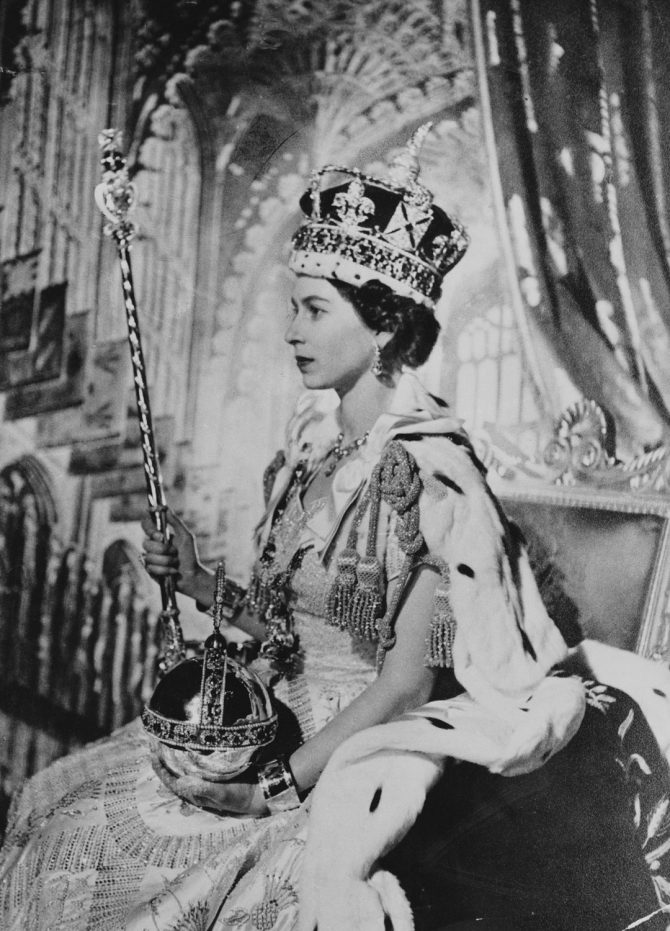 Queen Elizabeth wearing the Imperial State Crown as she holds the scepter with the cross and Cullinan I as well as the solid gold orb. Photo Royal Collection