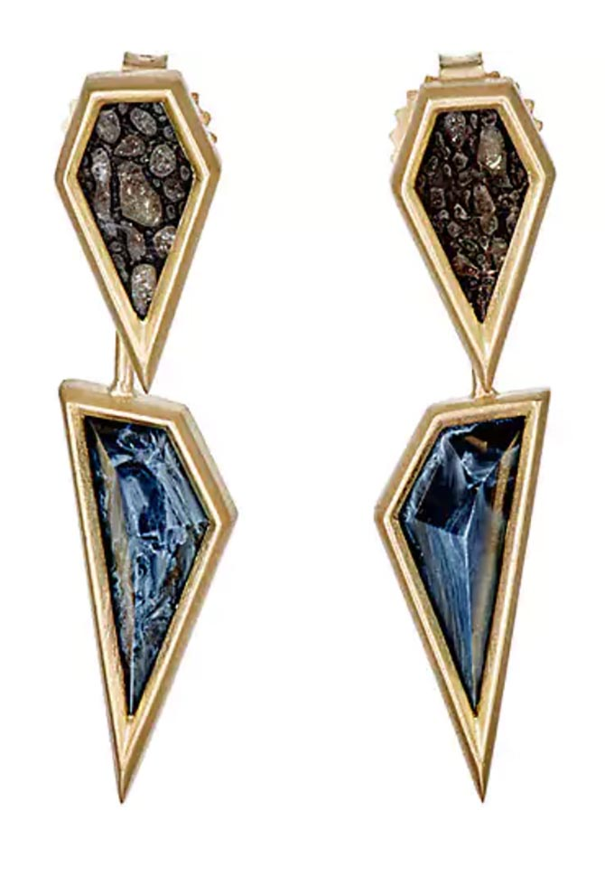 Monique Péan's fossilized dinosaur bone and 18k yellow gold stud earrings are anchored by geometric pietersite drops. Photo Barneys