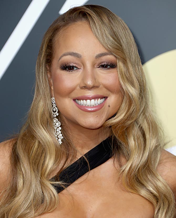 Mariah Carey in long diamond pendant earrings at The 75th Annual Golden Globe Awards