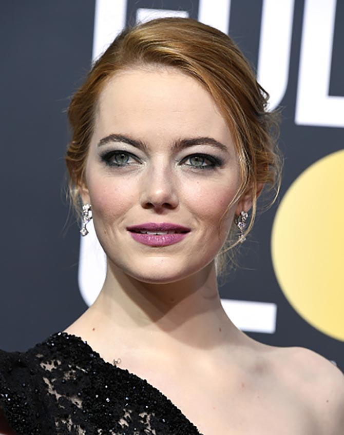 Emma Stone in Louis Vuitton diamond earrings at the 75th Annual Golden Globe Awards at The Beverly Hilton Hotel on January 7, 2018 in Beverly Hills, California. Photo Steve Granitz/WireImage